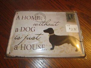 Home without a dog sign and other collectible tin signs