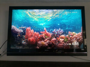 """52"""" Sony Bravia TV with Sony Home Theater System"""