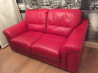 Red leather two seater sofa