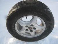 4 Goodyear (215 70R15) avec mags Pontiac (225$ / 4)