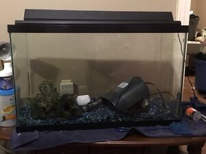 35G tank with filter and heater : 50$!!!