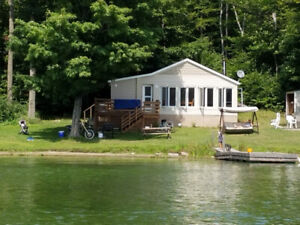 Book Now & SAVE $300 OFF - Beautiful Dog Lake Cott