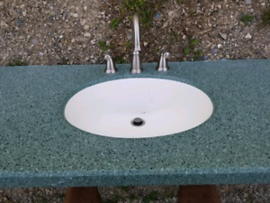 Green counter top with Moen tap set