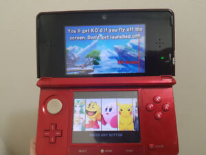 Red Nintendo 3ds with lots of games and accessories