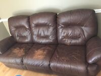 Bonded leather reclining couch.