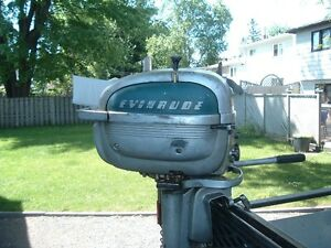 old evinrude outboard 7.5 hp.