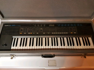 Roland E20 and Rhodes 660 synthesizer