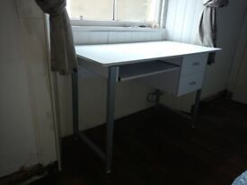 White desk with drawers and keyboard shelf