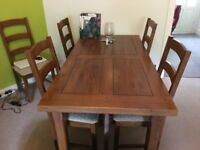 Solid oak dining table with extendable leaf