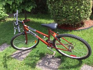 Vélo rouge pour femme