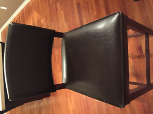 2 dark brown bar stools