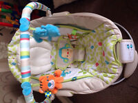 Baby bouncer plays lullabies and vibrates