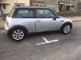 Mini Cooper (call to make an offer)