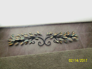 Beautiful sophisticated wall art with green/golden leaves. 4 ft