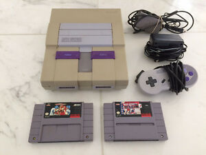 Super Nintendo System with All Hook Ups and 2 Games. Works Great