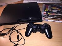 Slim PlayStation 3 with 5 games, controller and cables included