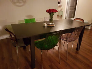 Dinning table with 6 desniger brand chairs