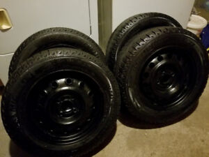 185/65r14 Michelin X Ice Snow Tires on 4x100 Honda Civic rims