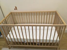 Wooden cot including mattress