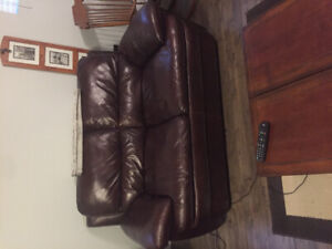 Leather love seat.  Burgundy and very comfortable.