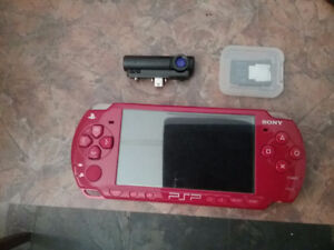 PSP Red God of war edition + 8 games and 1 Umd movie + camera