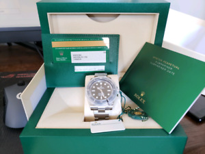 New 2018 Rolex Submariner w box and papers AND WARRANTY TIL 2023