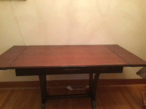 Hardwood old fashioned dining table