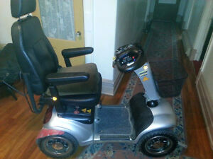 Four Wheel Mobility Scooter - asking $1850   /  Paid 4500$