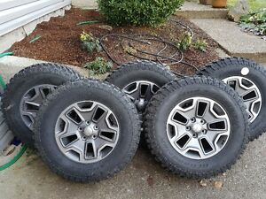 "Set of 5  32"" X 10"" tires on 17"" rims"