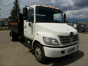 "Hino with On-trux Roll off System ""New Dump Body"""