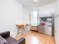 MODERN, SELF-CONTAINED studio flat with FULLY FITTED bathroom, WOOD FLOORS & SPACIOUS RECEPTION.