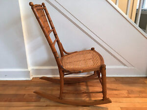 Antique Spindle Back Oak Rocker