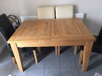Solid oak dining table. With six oak and leather dining chairs. Bought for £2000 excellent condition