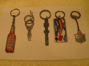 FOUR INTERESTING COLLECTIBLE VINTAGE KEY RINGS