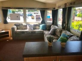 Starter Caravan sited on holiday park with entertainment and pools. South Coast