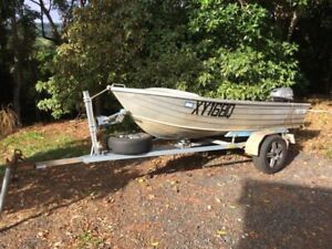 Tinny boat and trailer