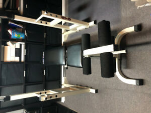 York Squat Rack / Bench Press Rack with weights and bars.