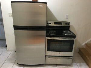 Stainless steel whirlpool fridge GE stove kitchen appliance set