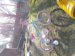 "Girls 16"" huffy bike with training wheels"