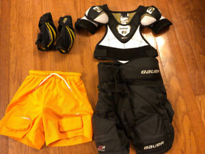 FOUR PIECES YOUTH HOCKEY EQUIPMENT, PANTS, SHORTS ETC