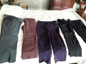 FIVE pairs of designer pants size 16