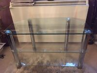 TV Stand. Glass with metal legs.