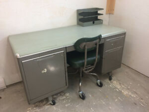 Antique metal stenographers desk and chair.