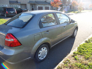 2008 Pontiac Wave Sedan with Safety and E-Test -Negotiable price