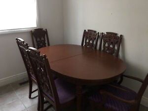 Real hardwood dining table with six sturdy chairs