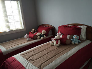 Twin beds with mattresses and bedding