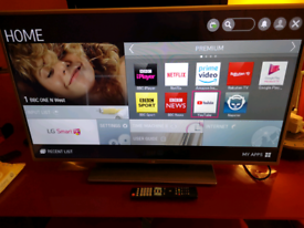 "42"" LG smart TV with remote control"