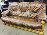 As new chestnut brown leather 3 and 2 in an oak frame with draws