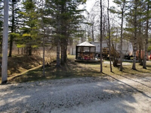 Seasonal Site in gimli with trailer and bunk house.