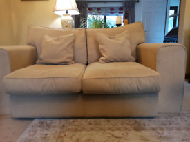 Two seater gold sofa